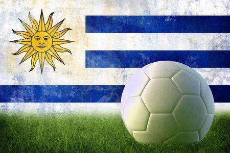 Grunge Uruguay flag on wall and soccer ball photo
