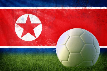 Grunge North Korea flag on wall and soccer ball photo