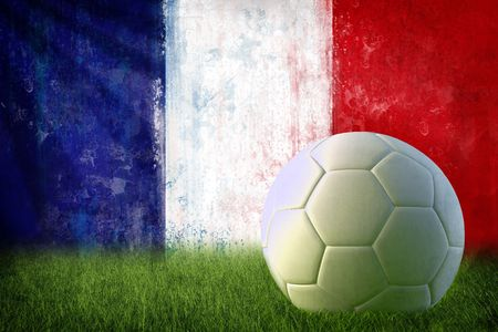 france painted: Grunge France flag on wall and soccer ball