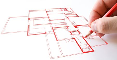 House plan drawing with red pencil on paper photo