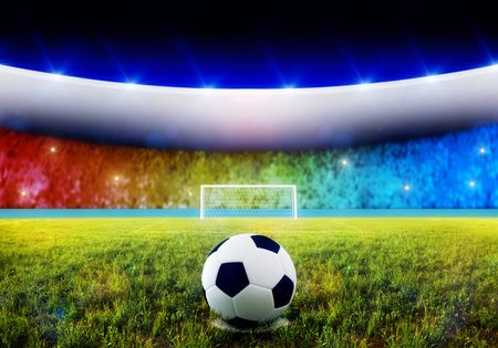 Soccer ball on penalty disk in the stadium photo