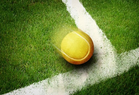 ball point: Tennis ball to corner in grass field line Stock Photo
