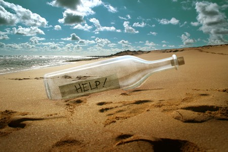 message: Help message in a bottle on beach