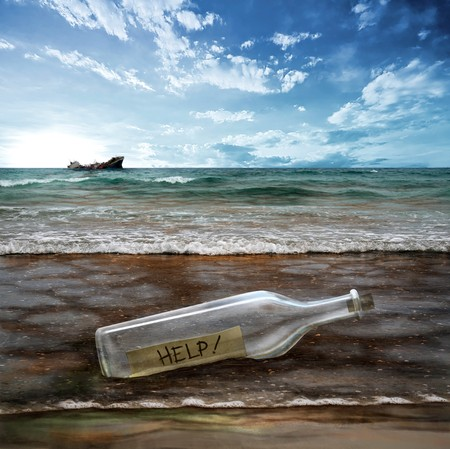 Help message in a bottle with background contaminated sea photo