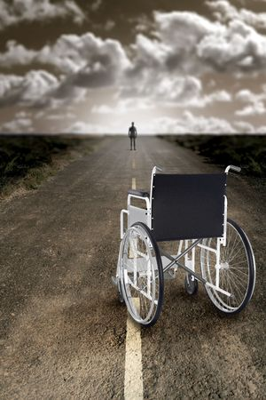 Man abandons the wheelchair and recommences to walk photo