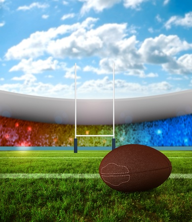 football pitch: Rugby ball on field with stadium of background Stock Photo