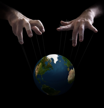 manoeuvre: Hand with cords manipulate the destiny of the world