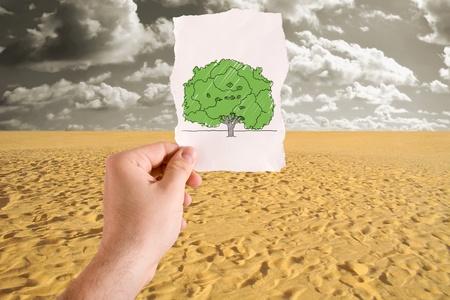 a mirage: A green tree idea for sand desert