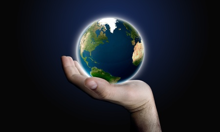 The globe world in man hand palm Stock Photo - 9553143