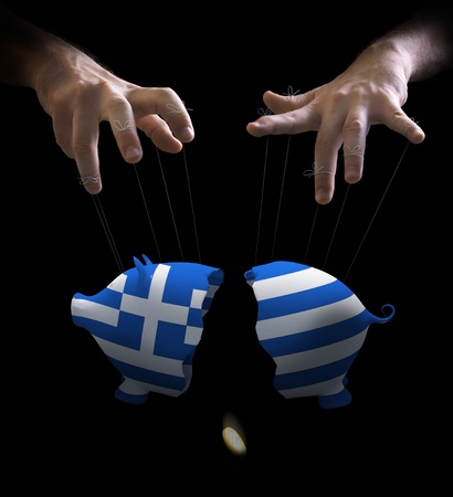 puppeteer: Hand with cords manipulate the Greek economy Stock Photo