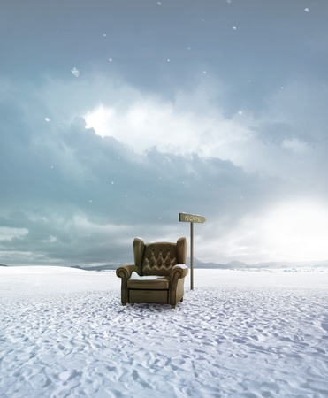 Old leather seat abandoned in the snow land and arrow indicates the hop Stock Photo - 13567500