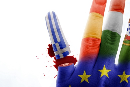 european economic community: Finger with the colors of the Greek flag is cut to hand with the European flag Stock Photo