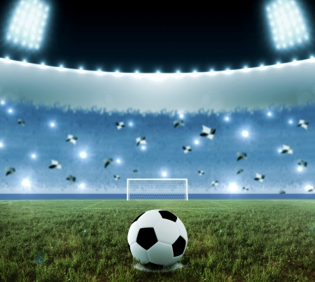 Soccer ball on penalty disk in the night stadium