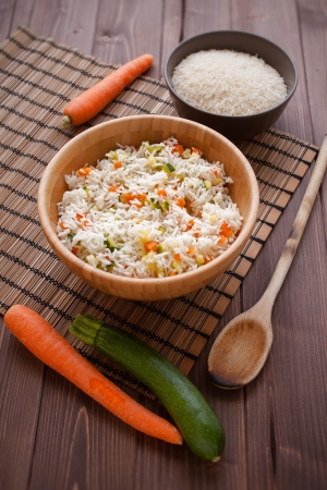 basmati: Basmati rice with carrots and courgettes in a dish on wood table