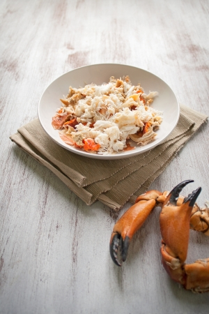 crab meat: Crab meat in a dish on white wood table Stock Photo