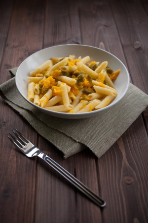 penne: Dish of vegetarian pasta with pumpkin and beans pod Stock Photo