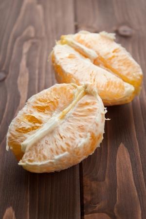vitaminic: Orange fruit peeled on dark wood table