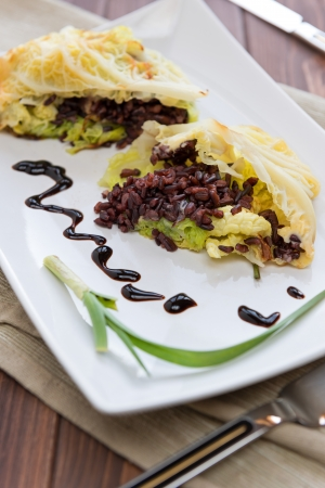 black rice: Roulade of cabbage and black rice in a dish Stock Photo