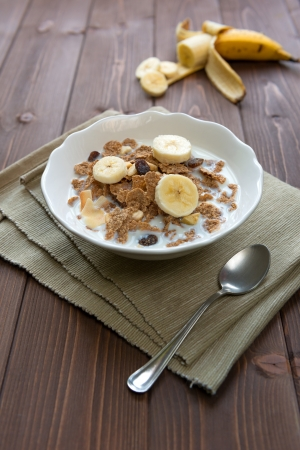 Bowl with corn flakes and banana for nourishing breakfast Stock Photo - 18220843