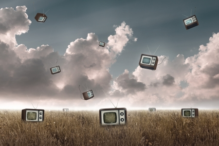 Many television falling to the sky in a meadow Stock Photo - 19561335