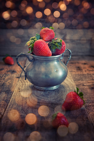 Strawberries cup on rustic wood aces table