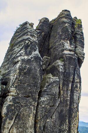 Solitary sandstone rock juts into the sky in 'Saxon Switzerland'