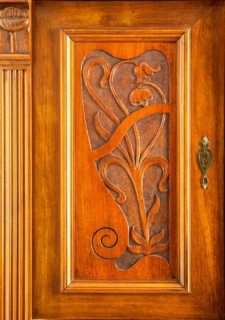 Beautiful Art Nouveau decor on a wooden cabinet door made in Saxony in 1905, hinged to the left