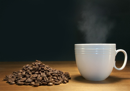 steaming hot coffee and coffee beans