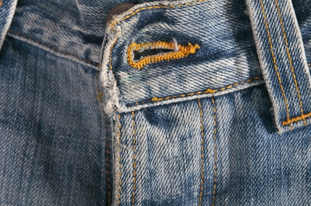 Top button hole on a pair of jeans Stock Photo