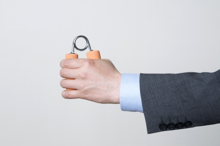 Man in a suit demonstrating strength Stock Photo