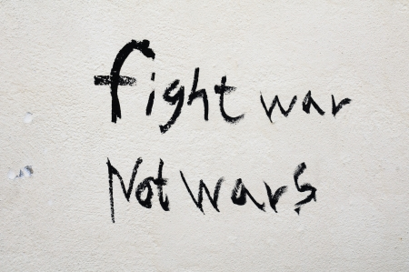 Fight war not wars text on a wall