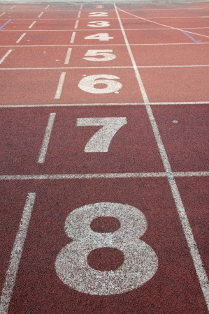 Running track with white lane numbers.