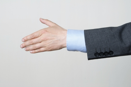 Businessman Reaching Out To Shake Hands