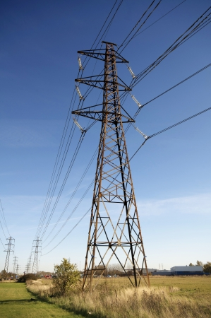 Power pole or electricity pylon and cables photo