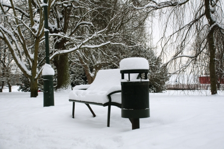 Bench in the park in winter.