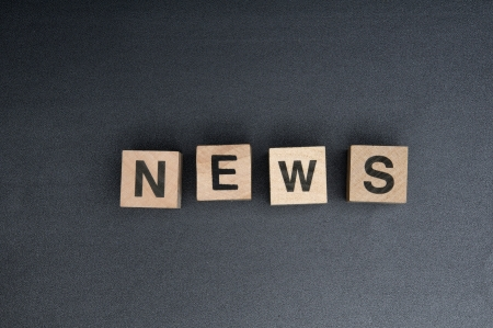 Wooden cubes with the word news. Stock Photo - 15779221