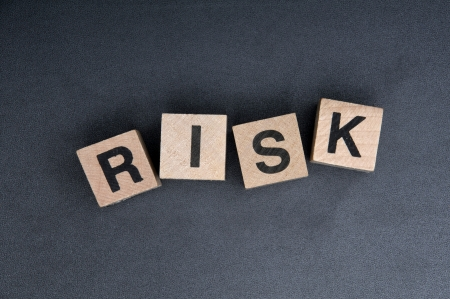 Wooden cubes with letters, spelling risk. Stock Photo - 15779217