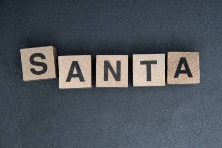 Wooden cubes with letters, spelling santa.