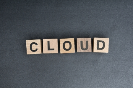 Wooden cubes with letters, spelling cloud. Stock Photo - 15952265