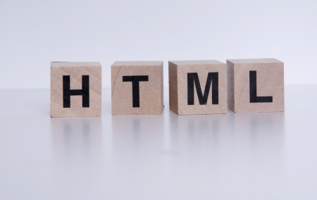 Wooden cubes with letters, spelling html. Stock Photo - 16126389