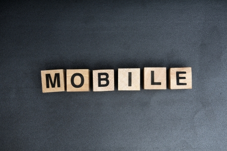 adaptable: Wooden cubes spelling mobile Stock Photo