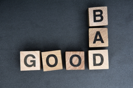 wooden cubes spelling bad good Stock Photo