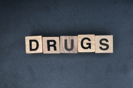 Wooden cubes spelling drugs Stock Photo