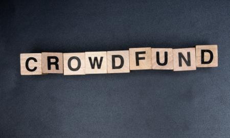 Wooden cubes spelling crowdfund