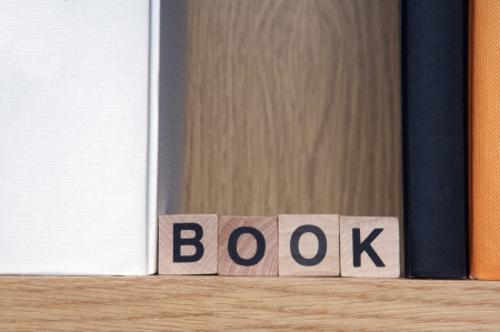 Books in a bookshelf with wooden cubes spelling book Stock Photo - 17284458