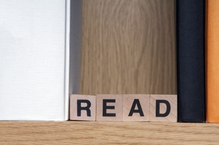 Books in a bookshelf with wooden cubes spelling read Stock Photo - 17284459