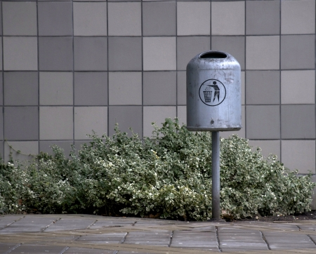 garbage can outside a building photo