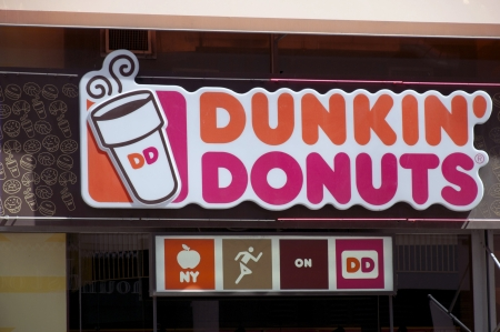 Dunkin Donuts sign outside one of their stores in New York, USA.