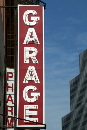 A neon garage sign in an urban setting  Stock Photo - 19635775