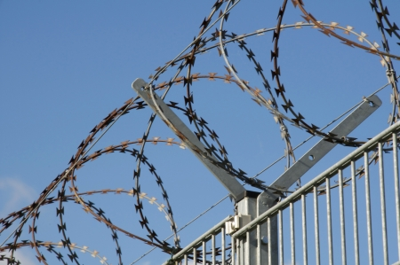 Razor and barbed wire fence.